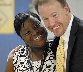 Superintendent Dr. Heath Morrison with a CMS Teacher